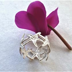 Anello in argento formato da sei piccole stelle marine